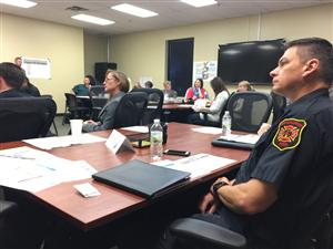 Firefighter at Meeting